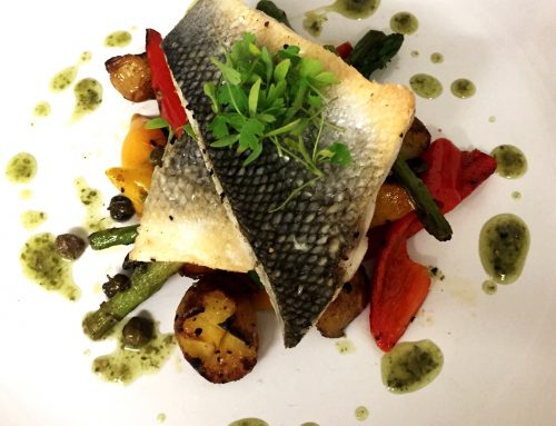 Seabass with lemon potatoes, asparagus and capsicum roast peppers